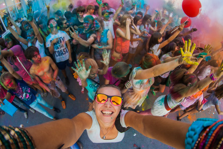 NOVOKUZNETSK, KEMEROVO REGION, RUSSIA-AUGUST 20, 2014 :: A group of a young people on the festival of colors Holi in Russia, Novokuznetsk. Selfie.