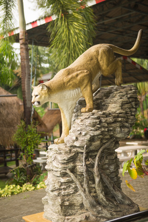 prowess: Statue of the hunting lioness in the garden.