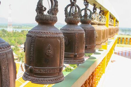 clang: Wishing bells in a Budhist Temple in Thailand