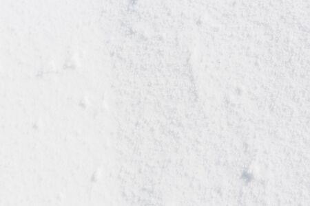 snow texture: Fresh white snow texture with shiny snowflakes.