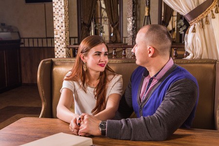 cosy: Young happy couple dating in a cosy restaurant