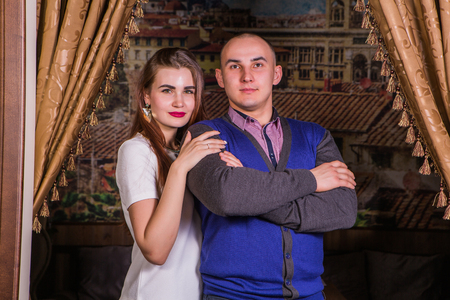 loved: Young elegant in loved couple in luxury restaurant interior Stock Photo