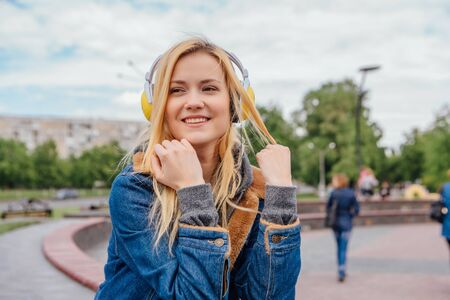 Girl listening to music streaming with headphones. Close up portrait. Stock Photo