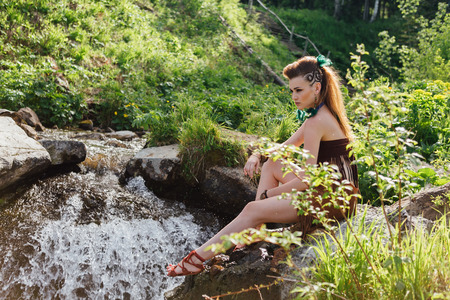 Young and beautiful savage girl near the river Stock Photo