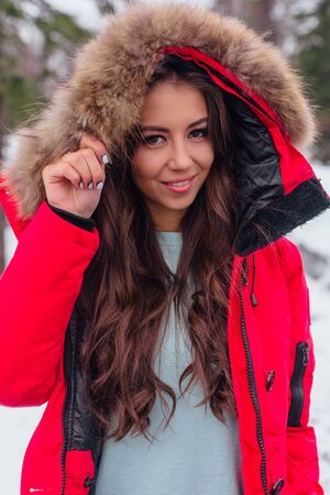 Winter portrait of young beautiful woman with make up. Winter beauty fashion concept.