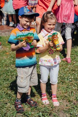 selebration: NOKUZNETSK, KEMEROVO REGION, RUSSIA - JUNE 01, 2012 :: Childrens protection day. Soup bubbles day selebration. Children are blowing soap bubbles