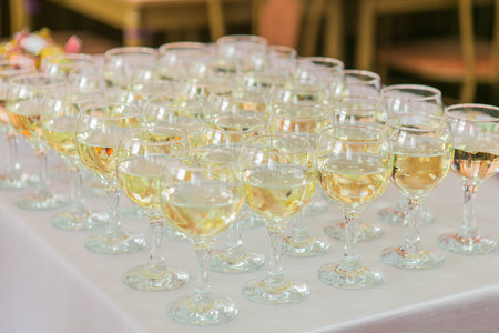 fizz: Glasses with champagne on the party table Stock Photo