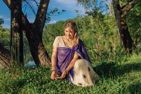 Beautiful european woman in traditional indian sari near the lake Stock Photo
