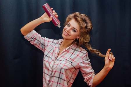 elegancy: Portrait of a young girl making hairdress with hairspray