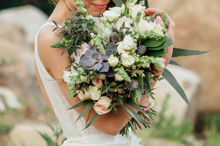 Beautiful wedding bouquet in the brides hands