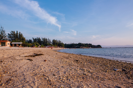 View of tropical sand beach of the island during sunset 免版税图像