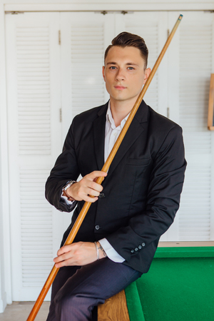 Young handsome man playing billiard game alone Archivio Fotografico