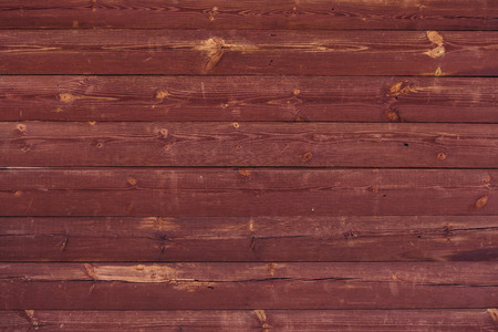 Painted red wooden vertical texture and background