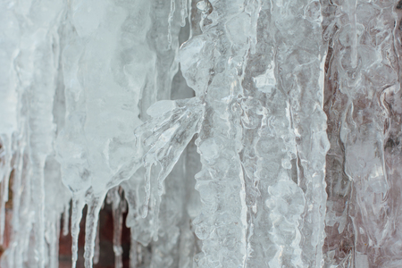 Very large and dangerous icicles close up in winter Standard-Bild