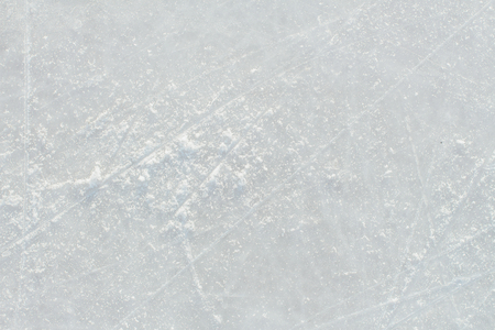 Ice background with marks from skating and hockey. Ice hockey rink scratches surface