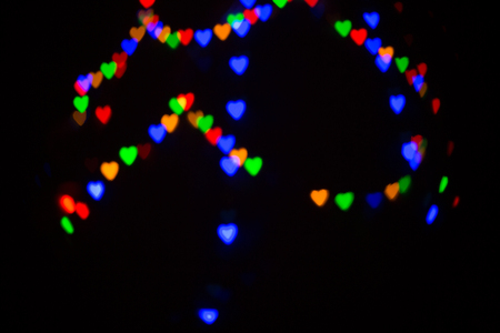 Colorful abstract heart shape blured bokeh at night time