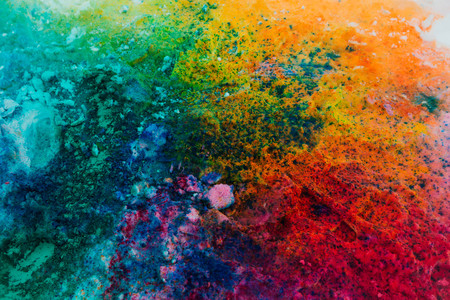 Background of colorful Holi powder in multiple colors on snow surface