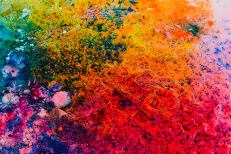 Background of colorful Holi powder in multiple colors on snow surface Stock Photo