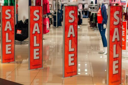 Entrance in shop with a sale sign. Sale in a shopping mall