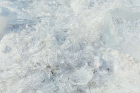 Amazing abstract broken ice crystals texture. Clear melting ice background. Фото со стока