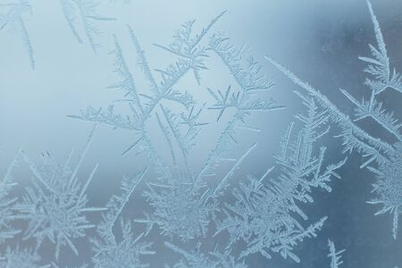 Frosty patterns on the glass on the window