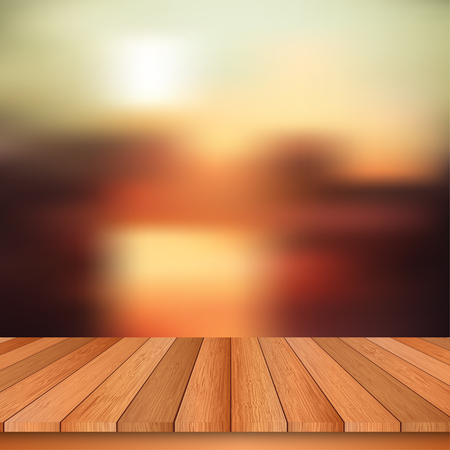 Wooden table and abstract blurred background.
