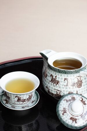 Tea water set for chinese tea style with white cup glass and white teapot on wood backplate Archivio Fotografico