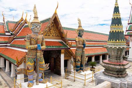The Royal Grand Palace and Temple of the Emerald Buddha Bangkok, Thailand - June 18,2020 : Giants Maiyarab with a light purple body and Virulchambang with a blackish-white body