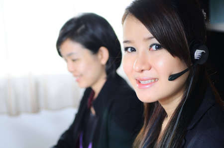 Customer support operator woman smiling at an office  photo