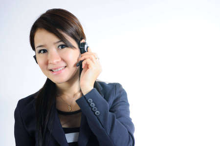 Young Beautiful and smiling call center operator with headset. Over white background  photo