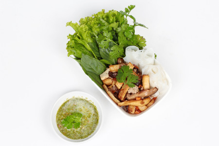 mixed vegetables: Roll noddle served with fried tofu and mixed vegetables on white background.
