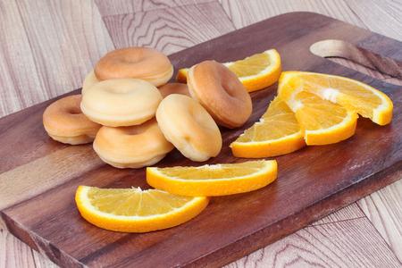 sliced orange: Milk donut with sliced orange home made. Selective focus Stock Photo