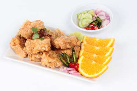 Fried tofu nuggets with minced shrimp and pork on white background. Selective focus.