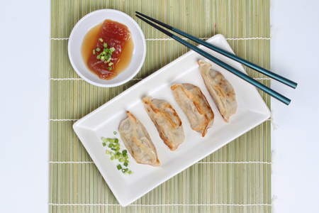 stuffing: Steamed stuffing flour as Gyoza and sweet sauce on bamboo. Stock Photo