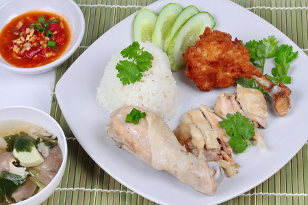 soy bean: Streamed oily rice and streamed chicken as Hainanese chicken rice and deep fried chicken served with spicy soy bean sauce and mushroom soup on Bamboo.