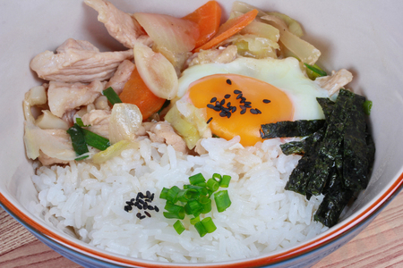 sesame street: Rice is topped soft boil eggs and fried pork in Japanese style  as Oyakodon . Close up