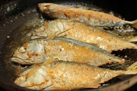 Hot cooking,Deep fried streamed mackerels Bplaa Thuu Nung Tod. Selective focus.