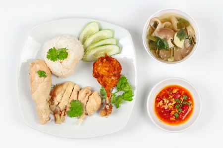 soy bean: Streamed oily rice and streamed chicken as Hainanese chicken rice and deep fried chicken s with spicy soy bean sauce and mushroom soup. Top view. Stock Photo