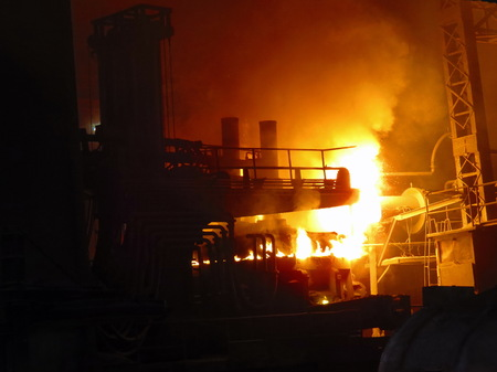 smelting plant: Heat and frame from iron melting. Stock Photo