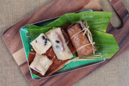 carretto gelati: Streamed sticky rice and black bean  in banana leaf as Khao Tom Mad in Thai. Top view.