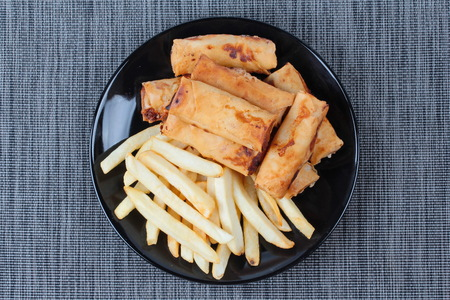 french roll: Chinese Vegetable festival  food as deep fried spring roll and French fries served.