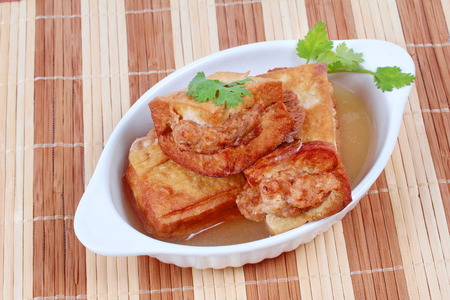 gold bar: Gold bar soup as fried tofu wrap minced pork in soup and coriander .