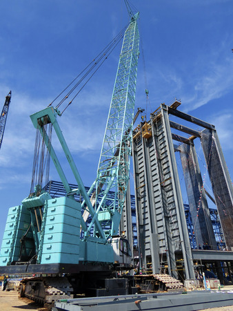 crawler: Hydraulic Crawler Cranes in Construction site and blue sky day