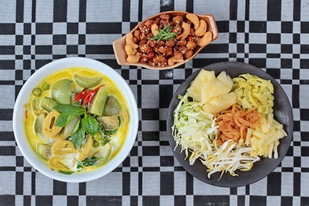 soy sprouts: mixed vegetables and spicy fried textured soy protein curry served with side disk as bean sprouts,cabbage,sweet radish and pickle Stock Photo