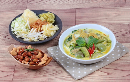 bean sprouts: mixed vegetables and spicy fried textured soy protein curry served with side disk as bean sprouts,cabbage,sweet radish and pickle Stock Photo