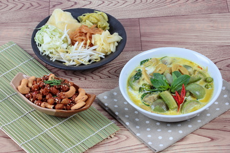 bean sprouts: Green fermented flour curry  with mixed vegetables and spicy fried textured soy protein curry served with side disk as bean sprouts,cabbage,sweet radish and pickle