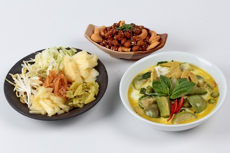 soy sprouts: Green fermented flour curry  with mixed vegetables and spicy fried textured soy protein curry served with side disk as bean sprouts,cabbage,sweet radish and pickle