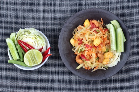 Spicy papaya salad with mixed vegetable call Som Tum J is organic food served.