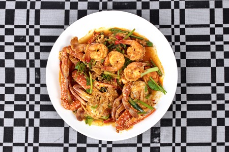 power food: Stir-fried crab and shrimp in curry power is top-ten of popular Thai food as seafood to fried with  fresh milk ,grill curry ,egg ,oyster oil and yellow curry power.