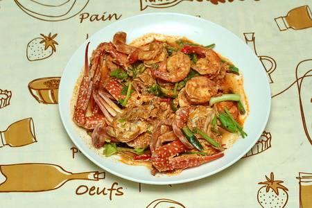 power food: Stir-fried crab and shrimp in curry power is top-ten of popular Thai food as seafood to fried with  fresh milk ,grill curry ,egg ,oyster oil and yellow curry powder.